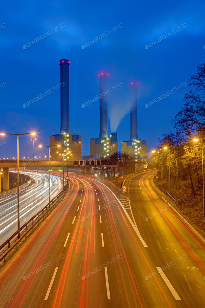 Highway and power station at night