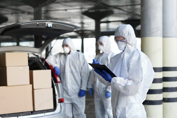 Virologists delivering vaccine to people on car, copy space