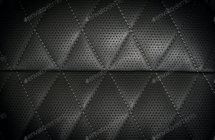 part of black perforated stitched leather details