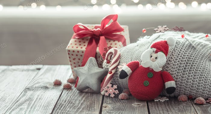 Cozy Christmas background on a wooden background .
