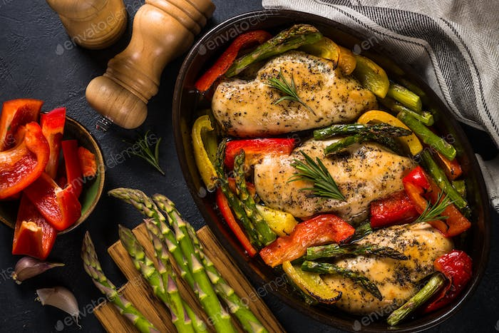 Baked chicken with vegetables top view
