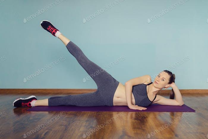 Junge Frau in Sportbekleidung