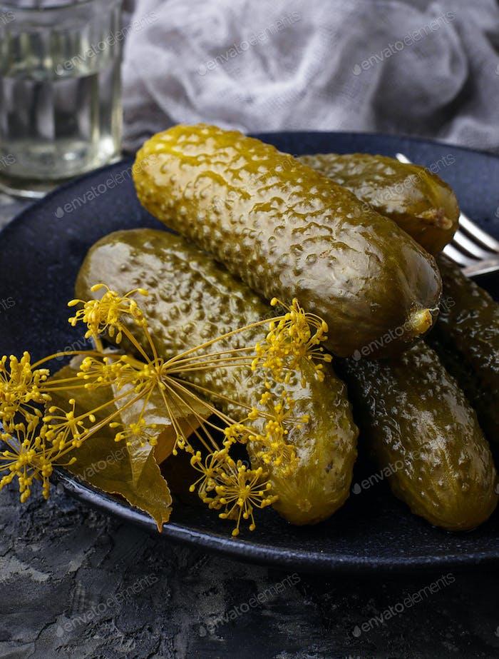 Pickled cucumbers in black plate