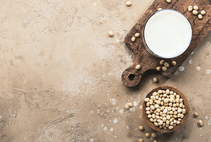 Soy milk and soy bean on beige background