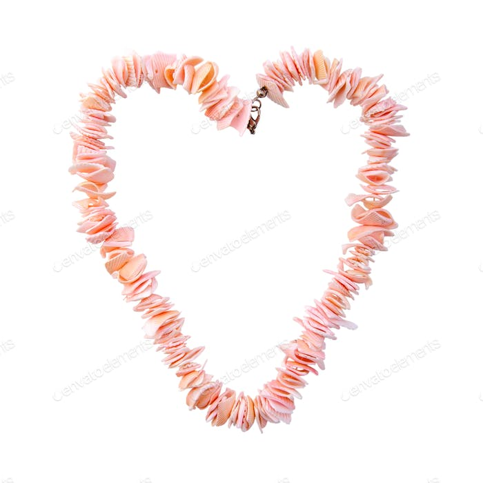 Coral beads in the shape of a heart on a pure white background.