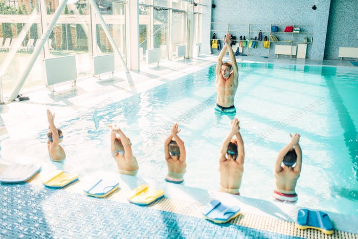 Kids doing exercise in swimming pool photo by NomadSoul1 on Envato ...
