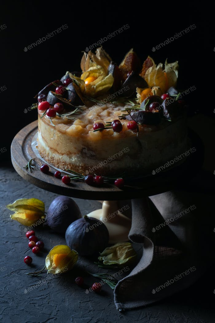 Cheesecake with figs and physalis on a holder