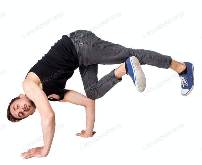 Break dancer doing handstand against  white background