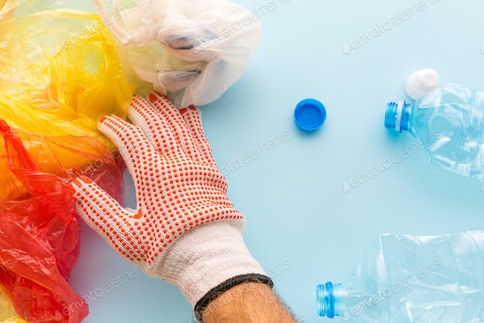 Worker sorting plastic garbage for recycling