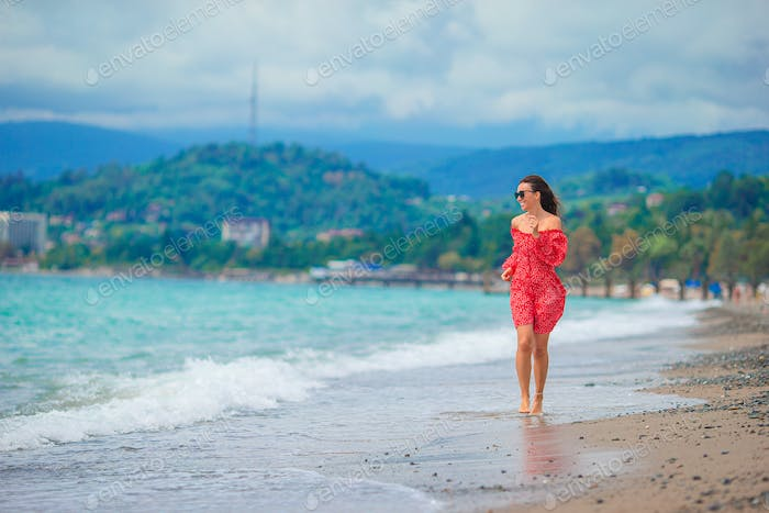 Young woman in white on the beach