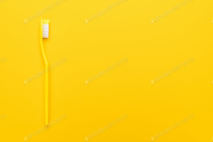 Plastic Toothbrush On Yellow Background