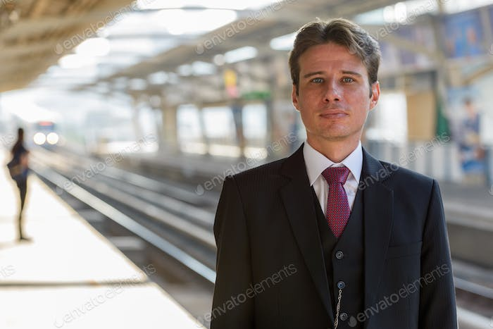 Portrait of businessman at train station in Bangkok Thailand