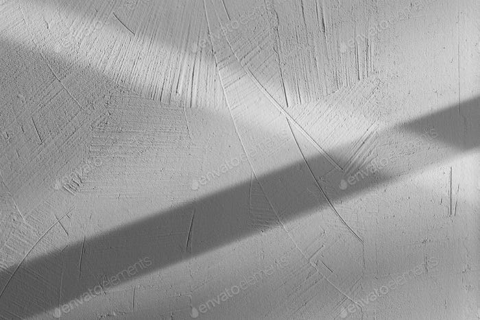 close-up view of light and shadow on gray concrete wall textured background