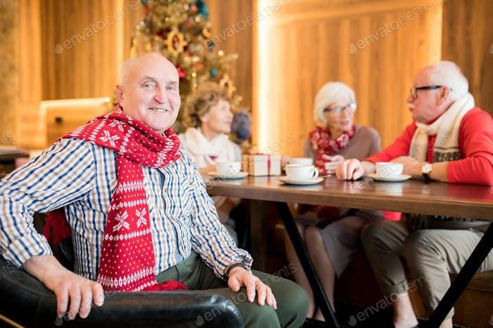 Happy chubby mature man in warm scarf
