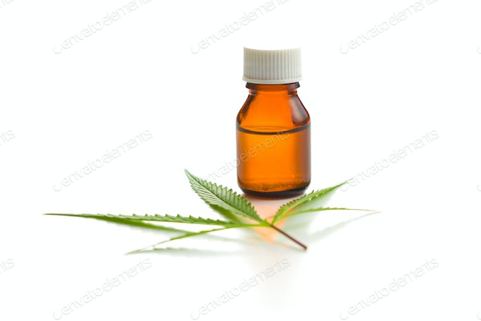 Marijuana cannabis leaf and cannabis oil extract in jar.