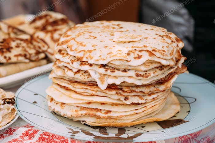 Dishes of the traditional Belarusian cuisine - pancakes.