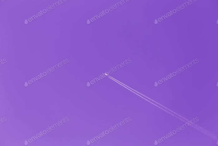 Contrail In Blue Sky. Plane, Clear Sunny Sky Ultra Violet Purple