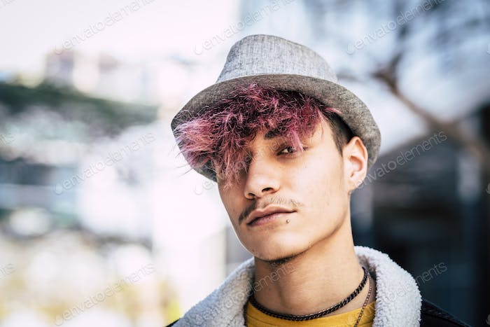 Handsome diversity young boy man portrait with violet hair and piercing