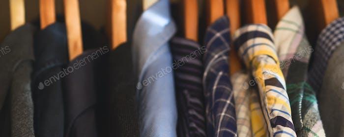 Man's closet hangers shirts closeup