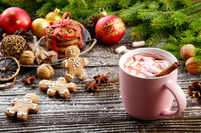 Christmas background of pink mug of hot chocolate with marshmall