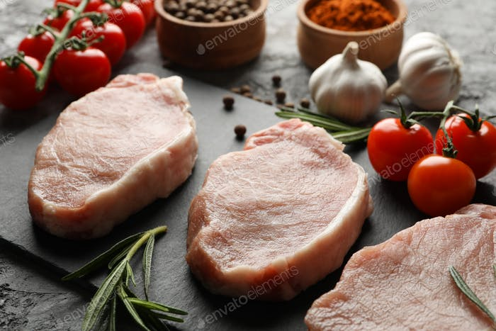 Composition with raw meat and ingredients. Cooking steak concept
