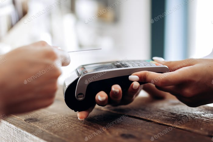 Payment by credit card in the flower shop