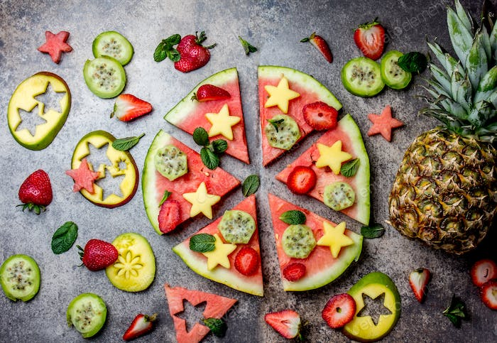 Fruit pizza. Watermelon mango, tuna and berries pizza. top view