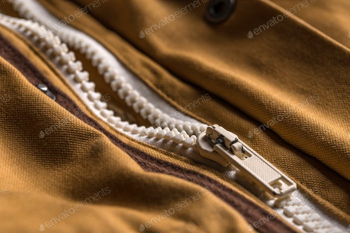 Zipper on brown coat