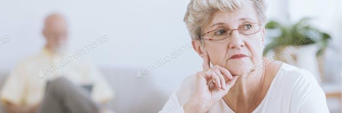 Panorama of sad elderly woman
