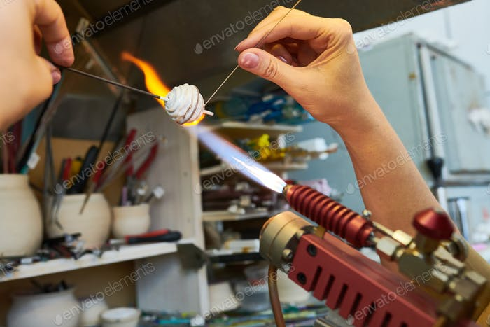 Artist Shaping Glass Beads in Flame