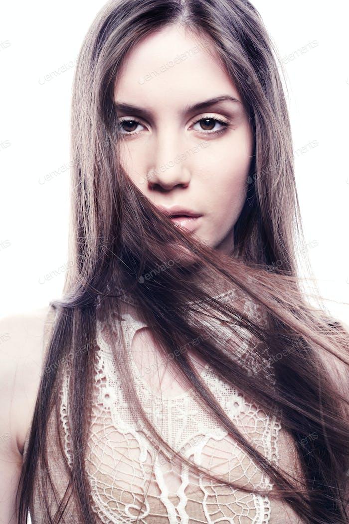 Fashion portrait of young beautiful elegant woman