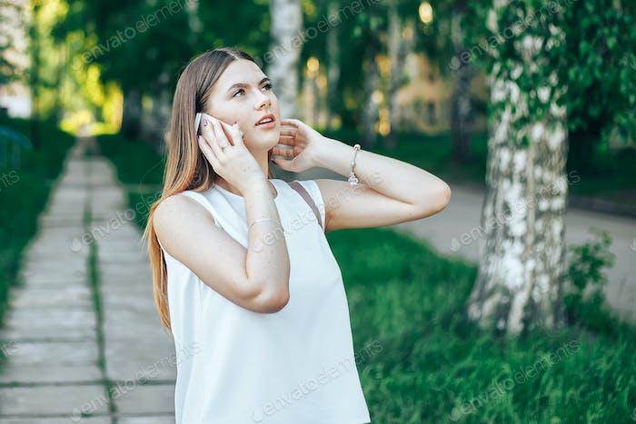 teenage girl talking phone