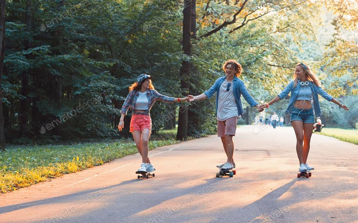 Young happy skaters on vacation