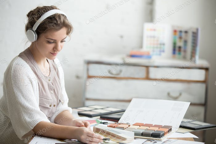 Young woman in headphones at work