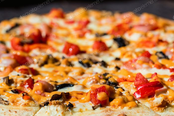 Delicious fresh pizza with shrimps, mushrooms and cheese close up texture