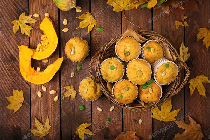 Appetizing and ruddy muffins with pumpkin and walnut. Flay lay. Top view
