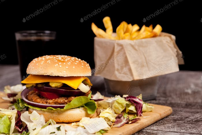 Close up of Delicious home made burger on wooden plate