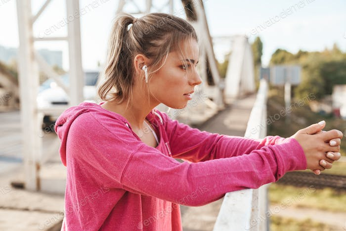 Attractive young fitness woman working out outdoors