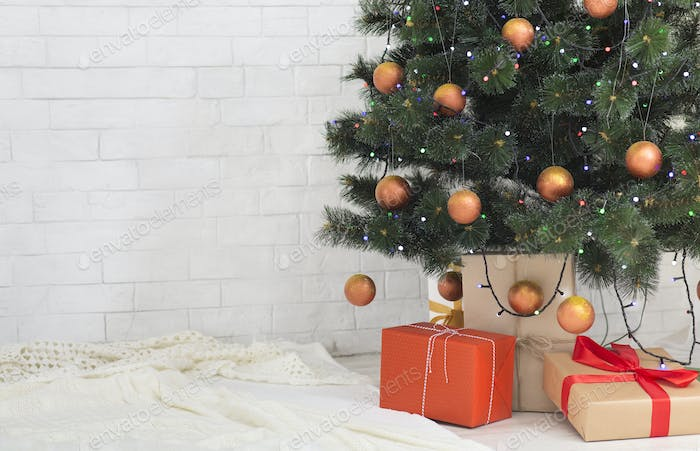 Christmas tree with gift boxes in home interior