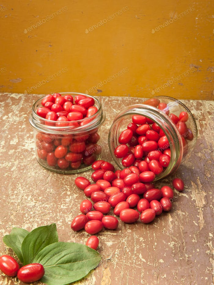 Jars with cornelian cherries fruit