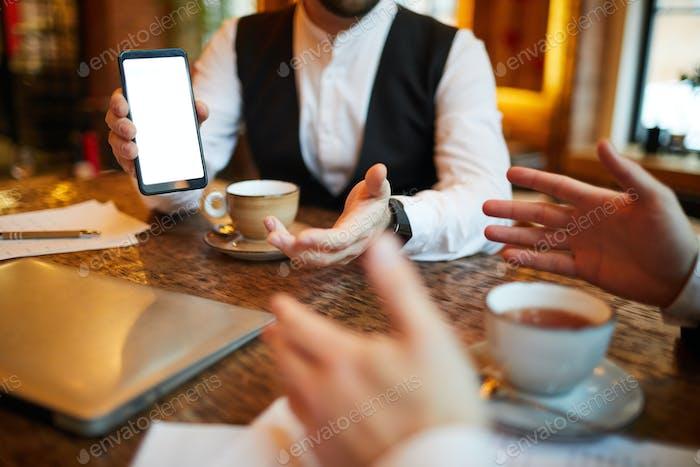 Businessman Showing Mobile App
