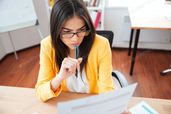 Businesswoman reading papers