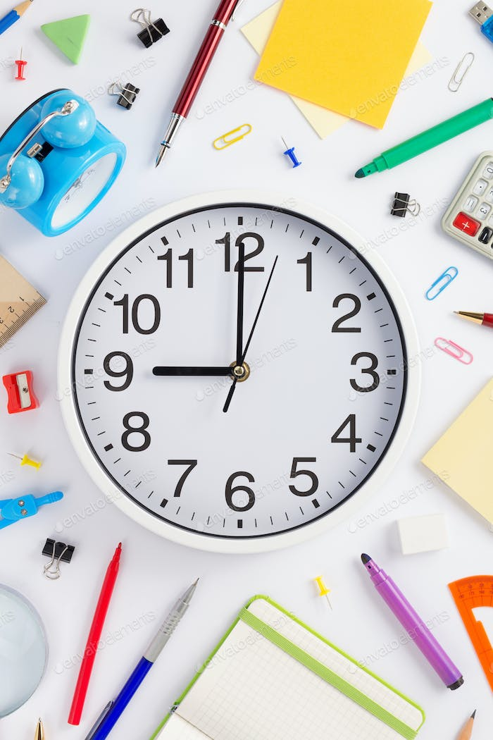 school accessories and wall clock on white  background