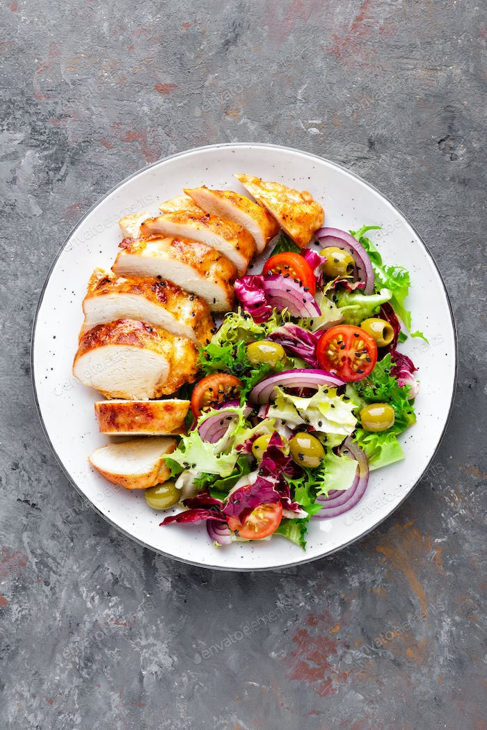 Grilled chicken meat, breast, fillet and fresh vegetable salad