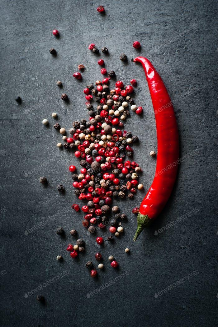 Peppercorns on a dark background