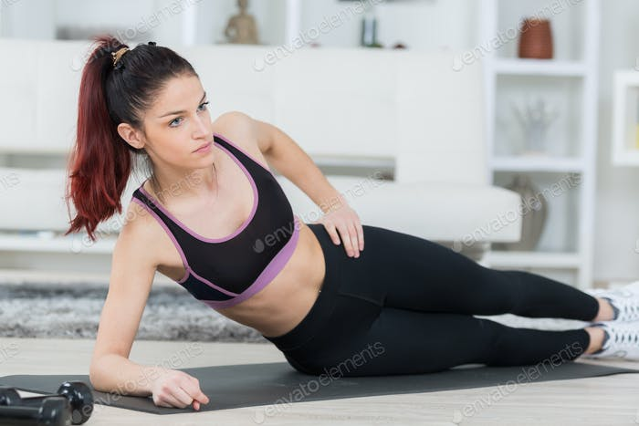 beautiful sporty woman doing exercise on the floor