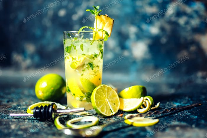 refreshment alcoholic cocktail drink at bar or pub. Gin and lime cocktail with pineapple and ice