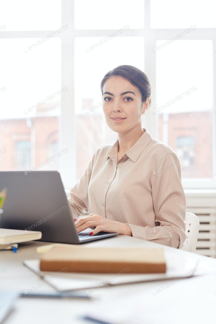 Portrait of Young Businesswoman at Workplace