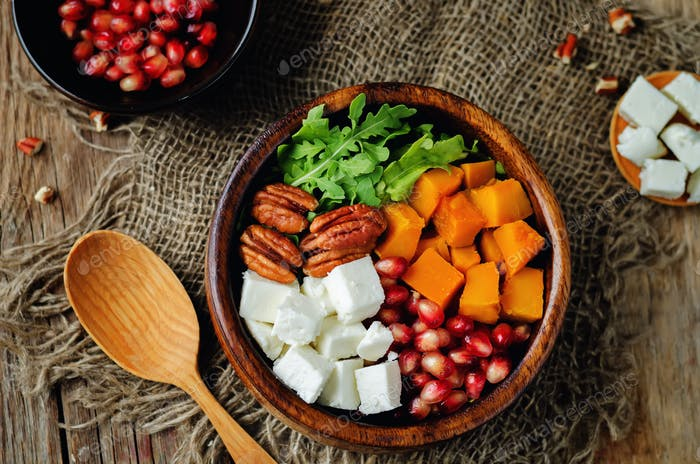 Pumpkin pomegranate pecan arugula goat cheese salad