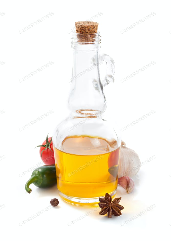 bottle of oil isolated and spices at white